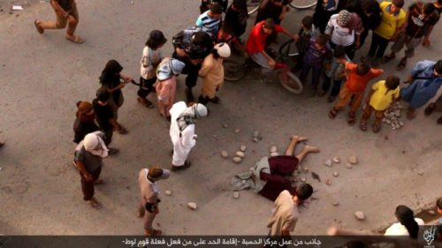 Image released by ISIS showing citizens of Kirkuk stoning the lifeless body of a man executed for being gay.