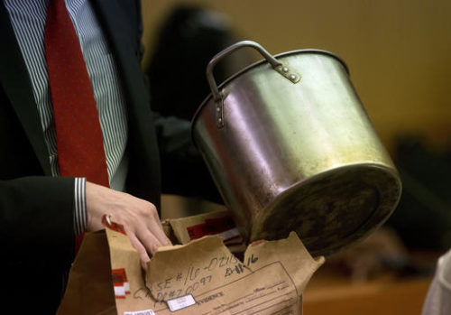 During the trial for Martin Blackwell a lawyer holds a pot they say Blackwell used to pour boiling water on his girlfriend's gay son and his friend as they slept, in Atlanta, Tuesday, Aug. 23, 2016.