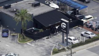 FILE - In this June 12, 2016 file photo, law enforcement officials work at the Pulse gay nightclub in Orlando, Fla., following the a mass shooting. Audio recordings of 911 calls released Tuesday, Aug. 30, by the Orange County Sheriff's Office show mounting frustration by friends and family members who were texting, calling and video-chatting with trapped patrons of the Pulse nightclub where Omar Mateen opened fire in June.