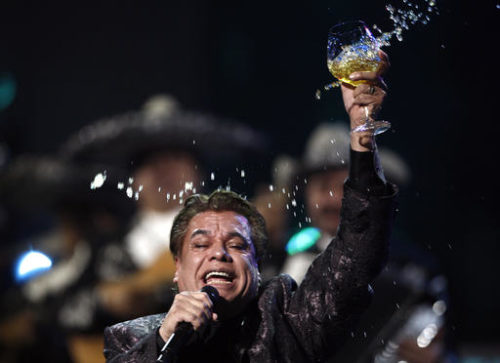 FILE - In this Nov. 5, 2009, file photo, Juan Gabriel performs at the 10th Annual Latin Grammy Awards in Las Vegas. Representatives of Juan Gabriel have reported Sunday, Aug. 28, 2016, that he has died.