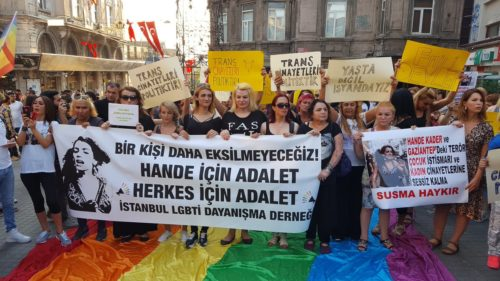 "Turkish activists gather to protest the rape and brutal murder of transgender woman Hande Kedar. The banner reads: ""We want to die of natural causes."""