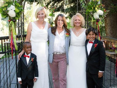 Betty Iverson, Kate Kendell, Jackie Biskupski and the couple's adopted sons Archie and Jack.