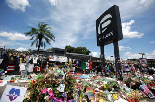 This Monday, July 11, 2016 photo shows a makeshift memorial outside the Pulse nightclub, a month after the mass shooting in Orlando, Fla. The more than 430 fundraisers posted on the GoFundMe website after the attack have exposed weaknesses inherent in these popular do-it-yourself charity campaigns: waste, questionable intentions and little oversight.