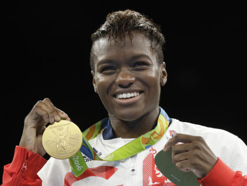 Britain's Nicola Adams displays her gold medal for the women's flyweight 51-kg boxing at the 2016 Summer Olympics in Rio de Janeiro, Brazil, Saturday, Aug. 20, 2016.