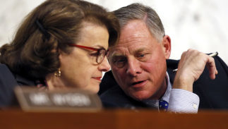 Senate Intelligence Chairman Richard Burr, right, is fighting for his political life.