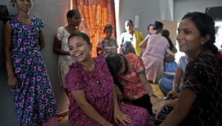FILE- In this Nov. 4, 2015 file photo, 26-year-old Christina Christian, center left, socializes with other surrogate mothers at a dormitory run by Akanksha Clinic, one of the most organized clinics in the surrogacy business, in Anand, India. The Indian government hopes to ban foreigners, single parents and gay couples from using India's surrogacy services in order to protect poor women from exploitation.A new legislation will soon be introduced in Parliament, where the governing Hindu nationalist Bharatiya Janata Party commands a majority in the lower house.