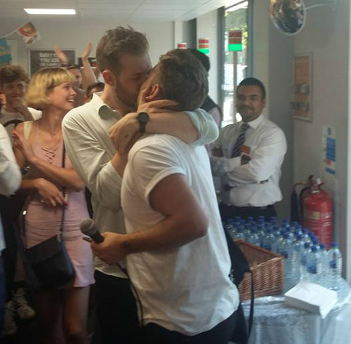 Nearly 200 protestors staged a kiss-in at a London store on Saturday.