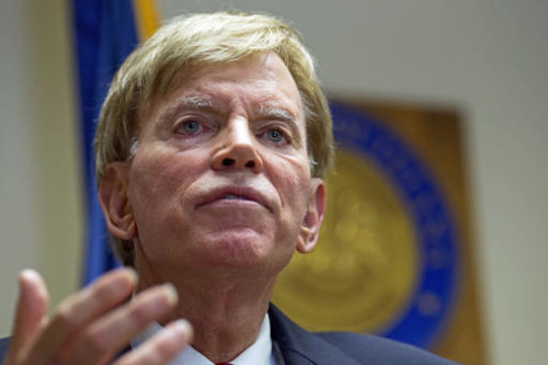 "FILE - In this July 22, 2016 file photo, former Ku Klux Klan leader David Duke talks to the media at the Louisiana Secretary of State's office in Baton Rouge, La. A war of words over Donald Trump's ""deplorables"" is intensifying as Republicans and Democrats fight to score political points over Hillary Clinton's charge that millions of the New York billionaire's supporters are racist, sexist and homophobic."