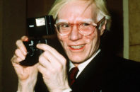 FILE - In this 1976 file photo, pop artist Andy Warhol smiles in New York. A representative Jared Leto confirmed on Sept. 20, 2016, that Leto will star as Warhol in an upcoming biopic.