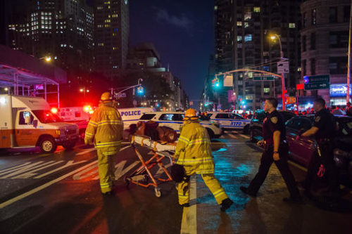 Police and firefighters work near the scene of an apparent explosion in Manhattan's Chelsea neighborhood, in New York, Saturday, Sept. 17, 2016. A law enforcement official tells The Associated Press that an explosion in the Chelsea neighborhood appears to have come from a construction toolbox in front of a building. The official spoke on condition of anonymity because the person wasn't authorized to speak about an ongoing investigation. More than two dozen people have sustained minor injuries in the explosion on West 23rd Street.