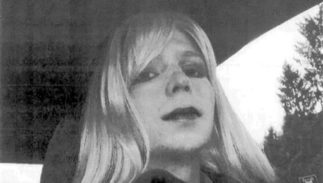 FILE - In this undated file photo provided by the U.S. Army Pfc. Chelsea Manning poses for a photo wearing a wig and lipstick. Manning, a transgender soldier imprisoned in Kansas for leaking classified information to the WikiLeaks website will end a hunger strike after the Army agreed to allow her to receive medical treatment for her gender dysphoria, the American Civil Liberties Union announced Tuesday, Sept. 13, 2016.