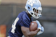 FILE - In this Aug. 5, 2016, file photo, North Carolina's Elijah Hood runs during NCAA college football practice in Chapel Hill, N.C. A year ago a 48-14 win over Illinois got North Carolina going and propelled the Tar Heels on a run to the ACC title game and a bowl. North Carolina goes up against the Illini again on Saturday, Sept. 10, 2016 in Champaign, Ill. (AP Photo/Gerry Broome File)