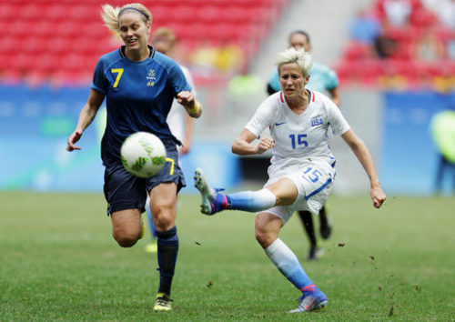 "FILE - In this Friday, Aug. 12, 2016, file photo, United States' Megan Rapinoe, right, kicks the ball past Sweden's Lisa Dahlkvist during a quarterfinal match of the women's Olympic soccer tournament in Brasilia. Rapinoe knelt during the national anthem Sunday, Sept. 4, before the Seattle Reign's game against the Chicago Red Stars ""in a little nod"" to NFL quarterback Colin Kaepernick."