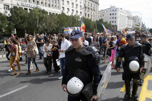 Serbian riot police guard Serbia's gay pride march in Belgrade, Serbia, Sunday, Sept. 18, 2016. Thousands of Serbian riot police have cordoned off central Belgrade for a gay pride march amid fears attacks from extremists in the predominantly conservative Balkan country seeking European Union membership.