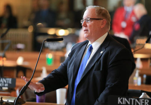 FILE - In this March 29, 2016 file photo, Nebraska state Sen. Bill Kintner of Papillion speaks during debate in Lincoln, Neb. The conservative Nebraska state senator is holding firm in his refusal to resign from office after admitting that he had cybersex on a state laptop with a woman he met online, Friday, Sept. 2, 2016. Members of the Legislature's Executive Board have threatened to recommend that he be impeached or expelled from the Legislature.