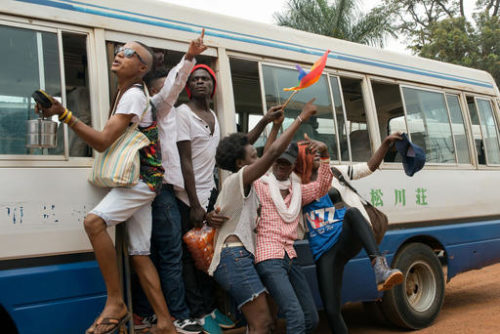 "Members of Uganda's gay and transgender community yell ""we want peace"" after police forced them to leave the gay pride festival in Entebbe, Uganda, Saturday, Sept. 24, 2016. Ugandan police on Saturday prevented organizers from holding a gay pride parade on the orders of a government minister who said such an event is illegal."
