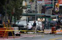 Crime scene investigators work at the scene of Saturday's explosion in Manhattan's Chelsea neighborhood, in New York, Sunday, Sept. 18, 2016.