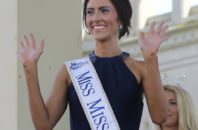 FILE - In this Tuesday, Aug. 30, 2016 file photo, Miss Missouri, Erin O'Flaherty waves as she is introduced during Miss America Pageant arrival ceremonies in Atlantic City. After competing in pageants for generations in the closet or working behind the scenes, gays and lesbians finally get to see one of their own take one of pageantry's biggest stages. O' Flaherty, will compete for the Miss America crown on Sept. 11, as the first openly lesbian contestant.