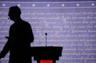 A producer walks past a podium on the stage for the presidential debate between Democratic presidential candidate Hillary Clinton and Republican presidential candidate Donald Trump at Hofstra University in Hempstead, N.Y., Monday, Sept. 26, 2016.