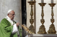 Pope Francis asperses incense as he celebrates a Jubilee Mass for catechists, at the Vatican, Sunday, Sept. 25, 2016.
