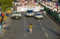 A 12 year old boy faces down with 11,000 homophobic protestors during a march against marriage equality in Celaya, Mexico.