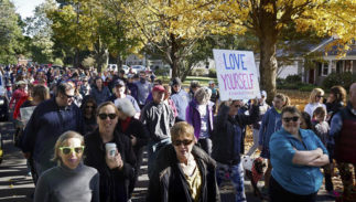 "People march for ""yoga pants parade"" in Barrington, R.I., Sunday, Oct. 23, 2016. Hundreds of women, girls and other supporters proudly donned their yoga pants Sunday afternoon as they peacefully paraded around the Rhode Island neighborhood of a man who derided the attire as tacky and ridiculous."