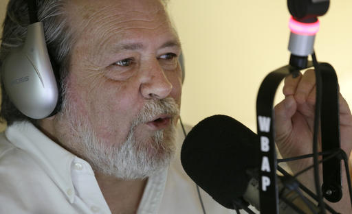 """Radio talk show host Rick Roberts speaks during his program in Dallas on Tuesday, Sept. 6, 2016. Roberts dismisses the concept of white privilege. His parents were never in his life, he says. He was left in the care of grandparents and, when they grew too old, he was emancipated at age 15 and landed at a boys' ranch. """"I fell on my ass more than I can count,"""" the 53-year-old says. """"I didn't feel real privileged at the time."""" He scraped his way up, earned an MBA and law degree, and before starting in radio 22 years ago, made a career negotiating offshore oil contracts."""