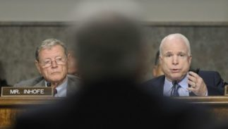Senator James Inhofe, left, and Senator John McCain, right, of the Senate Armed Services Committee.