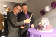 Bil Browning and Jerame Davis cut their wedding cake.