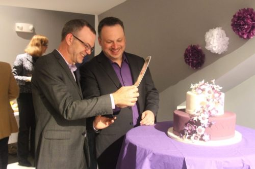 Bil Browning and Jerame Davis cut their wedding cake.