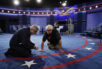 Workers prepare the stage for the second presidential debate between Republican presidential nominee Donald Trump  Democratic presidential nominee Hillary Clinton at Washington University in St. Louis, Saturday, Oct. 8, 2016.