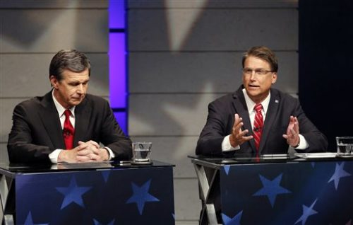 Candidates for Governor of North Carolina Democrat  Roy Cooper, left, and Republican Gov. Pat McCrory, right, debate at WRAL studios in Raleigh NC on Tuesday, Oct. 18, 2016.