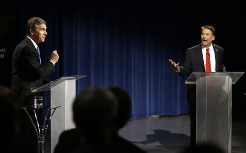 Democratic gubernatorial candidate Attorney General Roy Cooper, left, and North Carolina Republican Gov. Pat McCrory participate in a live televised debate at UNC-TV studios in Research Triangle Park, N.C., Tuesday, Oct. 11, 2016.