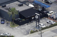 FILE - In this June 12, 2016 file photo, law enforcement officials work at the Pulse gay nightclub in Orlando, Fla., following a mass shooting. Police negotiators talking to gunman Omar Mateen at first weren't sure if the person they had on the phone was actually in the Pulse nightclub, according to audio recordings released Monday, Oct. 31, after a judge ruled they should be made public.