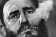 FILE - In this March 1985 file photo, Cuba's leader Fidel Castro exhales cigar smoke during an interview at the presidential palace in Havana, Cuba. Castro has died at age 90. President Raul Castro said on state television that his older brother died late Friday, Nov. 25, 2016.