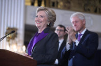 Former President Bill Clinton applauds as his wife, Democratic presidential candidate Hillary Clinton speaks in New York, Wednesday, Nov. 9, 2016. Clinton conceded the presidency to Donald Trump in a phone call early Wednesday morning, a stunning end to a campaign that appeared poised right up until Election Day to make her the first woman elected U.S. president.