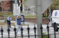 Edgar Maddison Welch, 28 of Salisbury, N.C., surrenders to police Sunday, Dec. 4, 2016, in Washington. Welch, who said he was investigating a conspiracy theory about Hillary Clinton running a child sex ring out of a pizza place, fired an assault rifle inside the restaurant on Sunday injuring no one, police and news reports said.