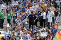 FILE - In this Monday, April 25, 2016, file photo, protesters head into the Legislative building for a sit-in against House Bill 2 in Raleigh, N.C. North Carolina legislators will repeal the contentious HB2 law that limited protections for LGBT people and led to an economic backlash, the state's Gov.-elect Roy Cooper said Monday, Dec. 19, 2016.
