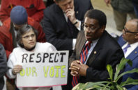 Rep. Garland Pierce, D-Scotland, addresses protestors during a special session at the North Carolina Legislature in Raleigh, N.C., Thursday, Dec. 15, 2016. Lawmakers finalized a $201 million hurricane and wildfire relief package Wednesday, sought by Gov. Pat McCrory in a special session he called. But they didn't go home as fellow Republicans then called their own session to weigh legislation, some of which could threaten the incoming Democratic governor.