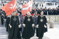 Members of the Knights of Malta walk in procession towards St. Peter's Basilica during a celebration to mark the 900th anniversary of the Order of the Knights of Malta, at the Vatican. The order traces its history to the 11th century with the establishment of an infirmary in Jerusalem that cared for people of all faiths making pilgrimages to the Holy Land. It is the last of the great lay chivalrous military orders like the Knights Templars that combined religious fervor with fierce military might to protect and expand Christendom from Islam's advance during the Crusades. In February 1113, Pope Paschal II issued a papal bull recognizing the order as independent from bishops or secular authorities, reason for Saturday's anniversary celebrations at the Vatican.