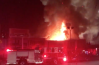 Flames overwhelm a Fruitvale warehouse where revelers — including numerous queer, trans, and gender non-conforming guests — gathered for a party. At least 9 people are believed to be dead, and dozens more are still missing.
