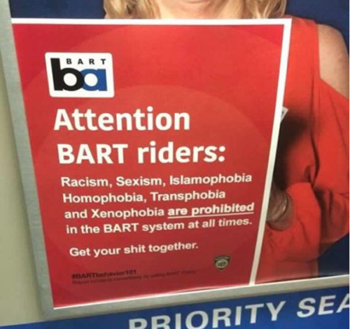 An unofficial BART sign advises riders to avoid bigotry.