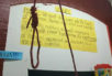 The noose, hung from the rafters at the center.