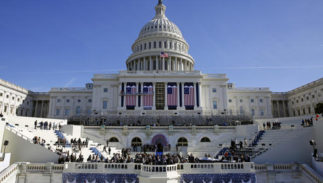 In this Jan. 15, 2016, photo, the U.S. Capitol frames the backdrop over the stage during a rehearsal of President-elect Donald Trump's swearing-in ceremony in Washington. Some two dozen House Democrats plan to boycott Trump's inauguration on Friday, casting the Republican businessman as a threat to democracy.