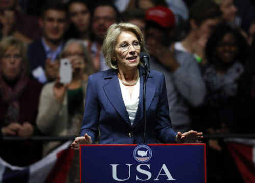 FILE - In this Dec. 9, 2016 file photo, Education Secretary-designate Betsy DeVos speaks in Grand Rapids, Mich.  DeVos, Trump's choice for education secretary, has spent over two decades advocating for school choice programs, which give students and parents an alternative to traditional public school education. Her confirmation hearing was scheduled for Jan. 17.