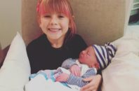 P!nk's daughter, Willow, holding baby Jameson.