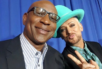 "Boy George poses with former ""Apprentice"" contestant Eric Dickerson."