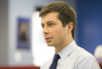 In this Wednesday, Jan. 4, 2017 photo, South Bend, Ind., Mayor Pete Buttigieg talks to a South Bend Tribune reporter regarding interest in the Democratic National Committee chairman position, inside the St. Joseph County Democratic Party headquarters in South Bend, Ind. Buttigieg announced his chairman candidacy Thursday, Jan. 5.