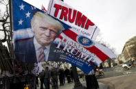 Flags with the image of President-elect Donald Trump are displayed for sale on Pennsylvania Avenue in Washington, Thursday, Jan. 19, 2017,  ahead of Friday's inauguration.