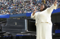 """FILE - In this Sunday, April 20, 2008 file photo, Kim Burrell performs prior to a Mass by Pope Benedict XVI at Yankee Stadium in New York. Ahead of a performance on the talk show """"Ellen"""" in early January 2017, gospel singer Burrell says she make """"no excuses or apologies"""" for a sermon at a Houston church where she referred to gays and lesbians as perverted."""